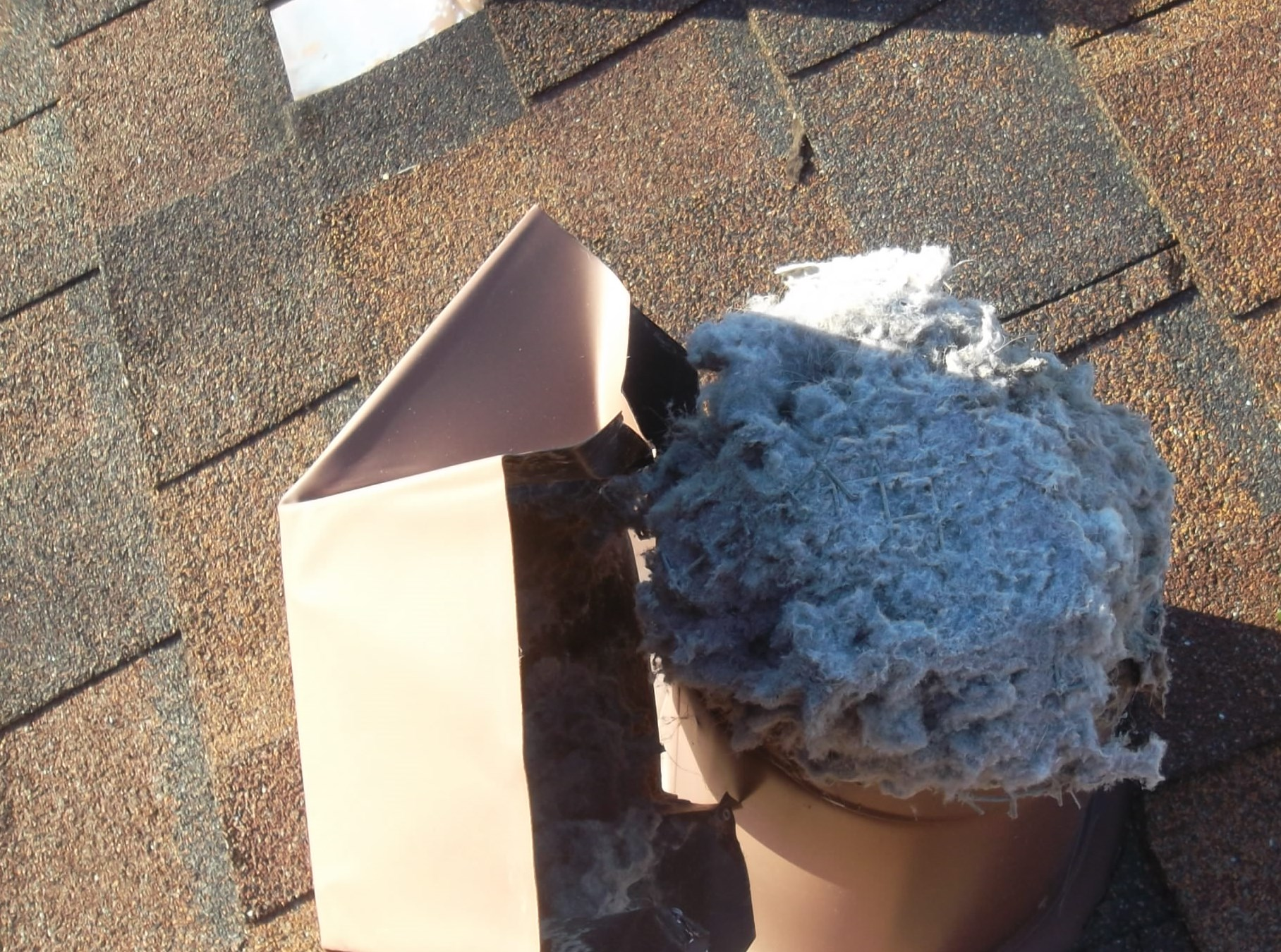 Dryer Vent Being Cleaned